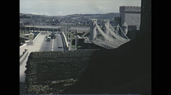 Vintage 16mm film, 1965, UK, Conwy Castle bridge and town Stock Footage