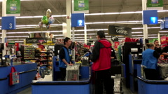 People paying foods at check out counter inside Walmart store Stock Footage
