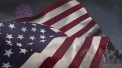 American flag blowing against fireworks - stock footage