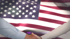 Hands shaking against american flag Stock Footage