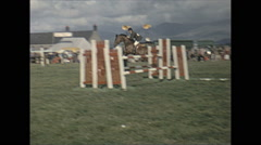 Vintage 16mm film, 1965, UK, horse jumping #4 Stock Footage