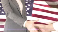 Business handshake against american flag - stock footage