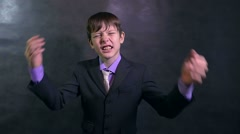 Angry businessman teenager boy shouting swears slow motion Stock Footage
