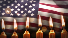 Candles against american flag Stock Footage