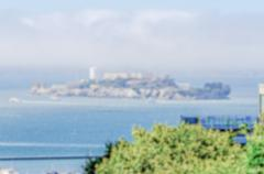 Defocused background of Alcatraz island in San Francisco, USA Stock Photos