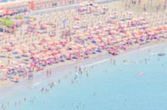 Defocused background with a crowded beach in  Italy - stock photo