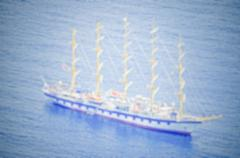 Stock Photo of Defocused background, Boat sailing on the Bay of Naples, Italy