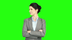 Businesswoman standing with arms crossed Stock Footage