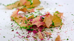 Pencil shavings drop on a white background - stock footage