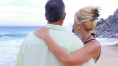 An older couple looking out at the ocean - stock footage