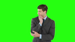 Businessman thinking with hand on chin Stock Footage