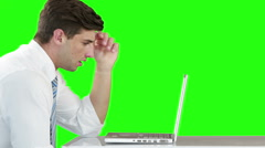 Worried businessman using laptop at desk Stock Footage