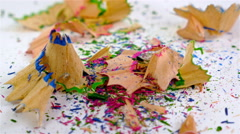 Pencil shavings drop on a white background Stock Footage