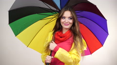 Woman wearing rainproof coat standing under umbrella 4K Stock Footage
