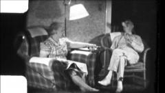 Old COUPLE Relaxing Living Room Reading 1940s Vintage Film Home Movie 8652b Stock Footage