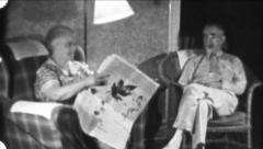 Old COUPLE Relaxing Living Room Reading 1940s Vintage Film Home Movie 5659 Stock Footage