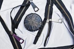 Zipper, thread, sewing needles, needlework. - stock photo