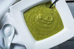 bowl of fresh green split pea soup - stock photo