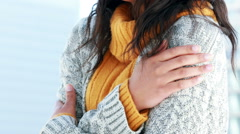 Woman shivering on a winters day Stock Footage