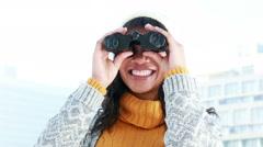 Pretty woman using binoculars Stock Footage