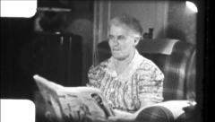 Old Woman Reading Newspaper 1930s Vintage Film Home Movie 8662 Stock Footage
