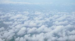 View from the top, above the clouds, rural scene below, space for text - stock footage