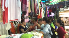 Tourists shopping in city market in Nha Trang city in Vietnam Stock Footage