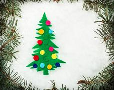 Christmas tree made of felt in the snow Stock Photos