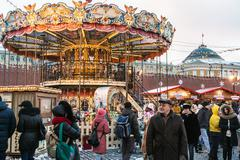 Tourists and townspeople at a Christmas sale at the Red Square Stock Photos
