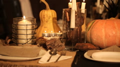 Pan shot candle and pumpkins on a table Stock Footage