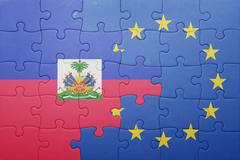 Stock Photo of puzzle with the national flag of haiti and european union