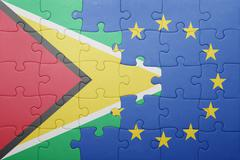 puzzle with the national flag of guyana and european union - stock photo