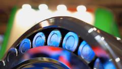 Chrome surface of the roller bearing shines brightly in different colors Stock Footage