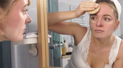 Woman removing facial clay mud mask in bathroom 4K Stock Footage