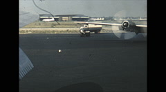 Vintage 16mm film, 1955, Idlewild Airport, taxi turn past Northwest Boeing 377 - stock footage