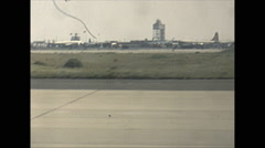 Vintage 16mm film, 1955, Idlewild Airport, take off run, control tower in bg - stock footage
