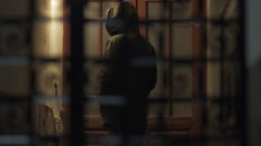 Silhouette of a man in a metal door Stock Footage