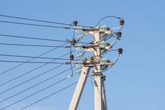 Stock Photo of Pillar power line installed thereon isolated wires