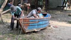 Polishing the boat at Phewa lake Stock Footage