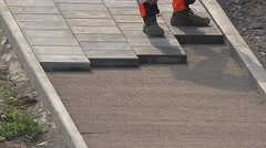 Unknown worker installing cement paver tiles. 4K Stock Footage