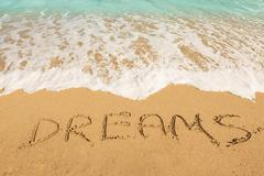 Stock Photo of Dreams message on the sand