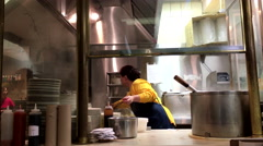 Boiling pork soup in the pot inside a restaurant kitchen. Stock Footage