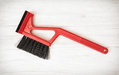 Red car brush with scraper - stock photo