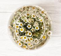 Arangement with daisy flowers in the glass bowl with water - stock photo