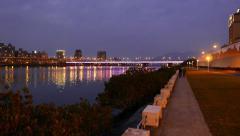 Taipei bridge illuminated in night, colorful line change color, fine reflection Stock Footage