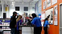 Best buy's black friday sale with shopper asking promotion item to buy Stock Footage