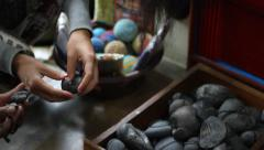 Female hands touches the stones - stock footage