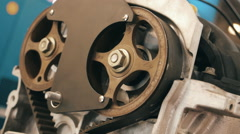 Pulleys, pinch rollers and timing belt of the internal combustion engine Stock Footage
