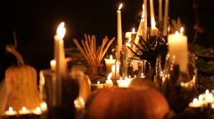 Halloween holiday table with candles and pumpkins - stock footage