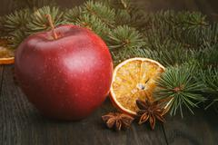 Traditional christmas decorations apple orange anise Stock Photos